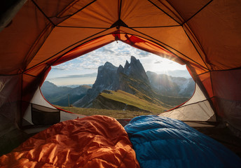 View from tent to the mountain. Sport and active life concept