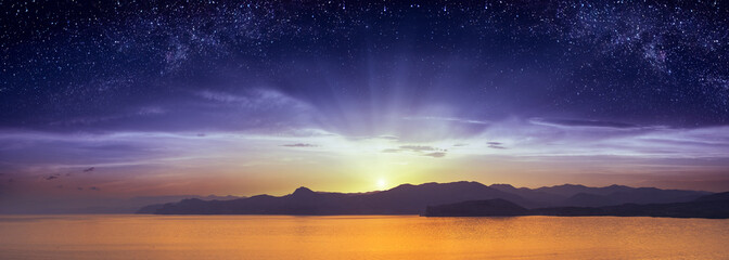 The sunrise with starry sky above the Crimea