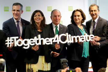 Mayors Eric Garcetti , Anne Hidalgo, Michael Bloomberg, Ada Colau and Giuseppe Sala pose together during a two-day summit of the C40 Cities initiative for Climate Change in Paris