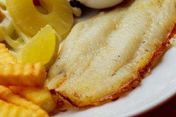 Deep Fried Dolly Fish Steak with French fries.