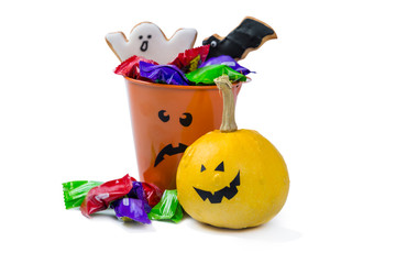 Halloween concept - basket with candies and ccokies