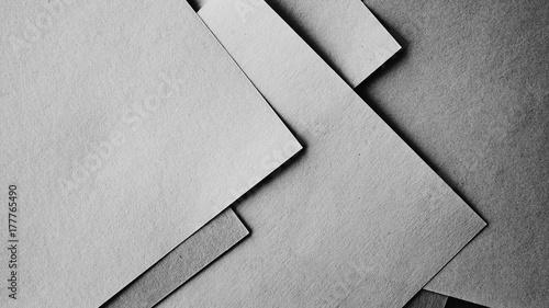 Minimal style papers in dark noir light room. office supplies top