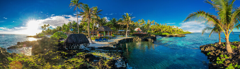 Panoramic holoidays location with coral reef and palm trees, Upolu, Samoa Islands.