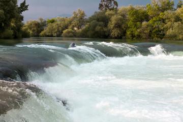 Mountain river, beautiful mountain shoal water. Water rapids. Mountain river, forest green rapid waterfall
