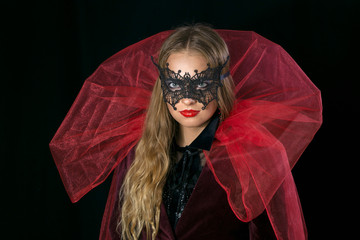 make-up girl witch on halloween costume in black mask.