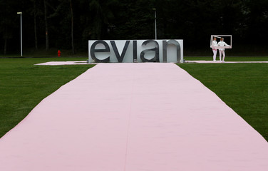 An Evian logo, part of Danone food company, is pictured outside the Evian water bottling plant in Publier near Evian-les-Bains