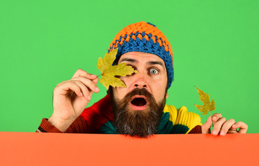 Fall season and fallen leaves time. Guy with surprised face