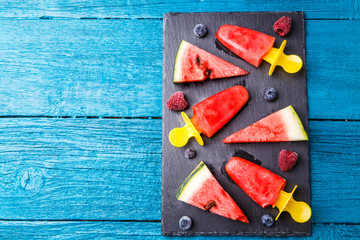 Photo of slices of watermelon, fruit ice, blueberries, raspberries