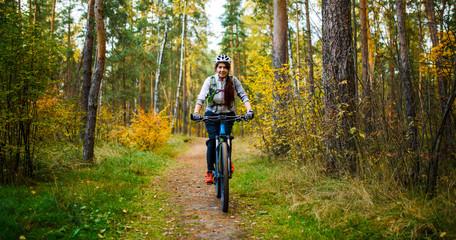 Photo of girl in helmet riding on bike