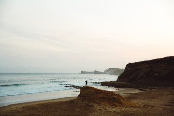 Unrecognizable man on coastal cliff