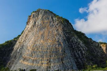 Golden Buddha laser carved on Khao Chee Chan Cliff, Sattahip, Chonburi province, Thailand