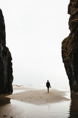 Man standing at cove