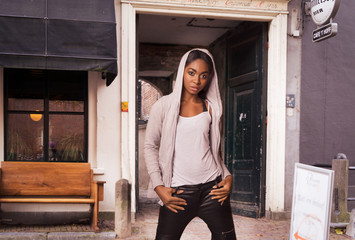 Nigerian model in front of an old gate. Citylook