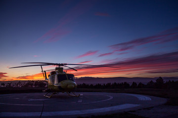 Helicopter in sunset