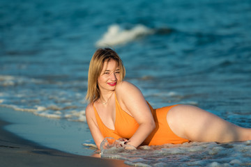 Young woman wear monokini enjoying the sea and the summer