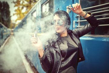 woman with e-cigarette on rust background