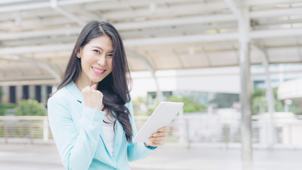 lifestyle business woman feel happy using smartphone ,  business concept