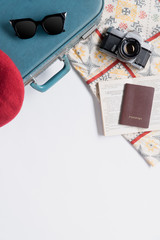 Flat lay of vintage suitcase and accessories with copy space