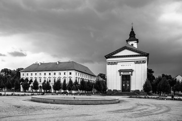 Czechoslovak Army Square with baroque church in Terezin fortress town, Czech Republic. Black and white image.