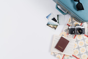 Flat lay and copy space of vintage suitcase and accessories with instant film