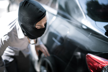robber in black mask. robbery and crime concept.