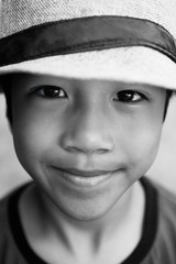 Reserved smile from a boy with hat