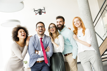 Young business people  letting the drone camera to fly over the office