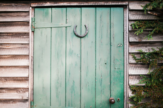 Lucky horseshoe on a wooden shed door