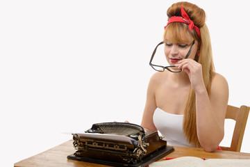 pin up girl typing on a typewriter, on white