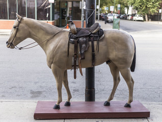 Statue of western horse with saddle