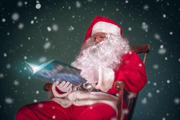 Santa Claus read book in snow nights.