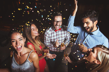 Group of people having a party on the roof celebrating New Year