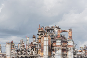 Oil refinery, oil factory, petrochemical plant in Pasadena, Texas, USA under cloudy sky.