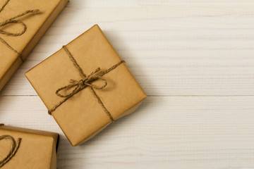 gift boxes package on white wooden background