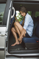 Attractive young woman in the car