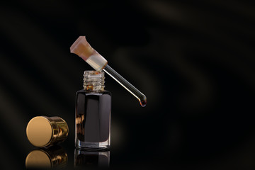 Macro Close Up Of Aromatic Essential Brown Oil Serum Droplet Or Dropper And Glass Bottle Natural Cosmetic Moisturizing Premium Treatment And Skincare On Black Background