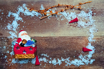 Decorate santa claus with snow on wood plate , have space for idea , christmas theme.