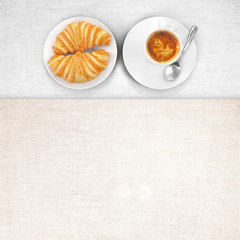 Table runner with cappuccino and croissant