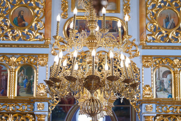 luxurious large chandelier with gold in a nice Christian church