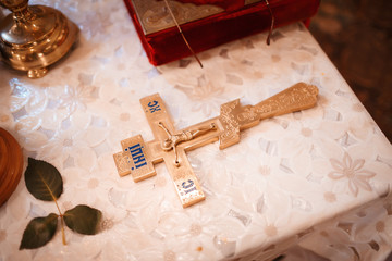 Cross lying on the table in the church