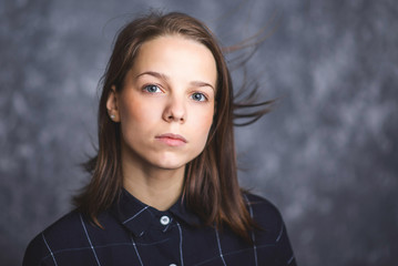 Portrait of a young brunette with sad and serious