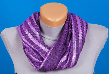 Lilac scarf on mannequin isolated on blue background.