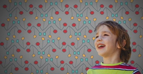 Boy against grey background happy and colorful pattern