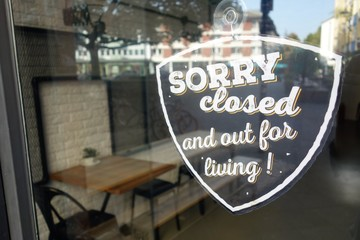 Sorry closed sign on urban restaurant