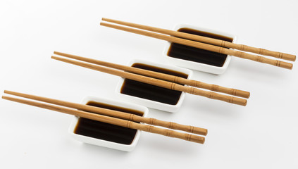 Three bowls of soy sauce isolated on white background