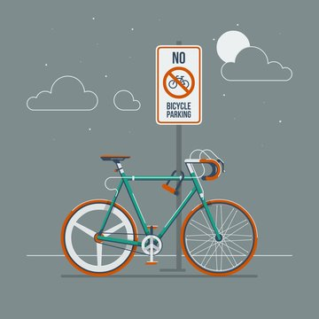 bike locked to a sign