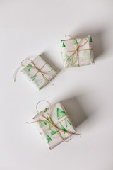 White: Scatterd Christmas Gifts Wrapped In Stamped Paper