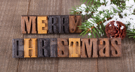 Merry Christmas Text on a Wooden Background