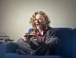 Excited teenager playing videogames
