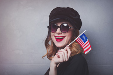 girl with flag of USA on grey background